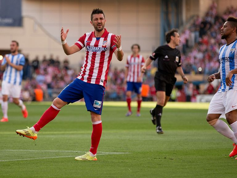 Atletico Madrid striker David Villa shows his frustration
