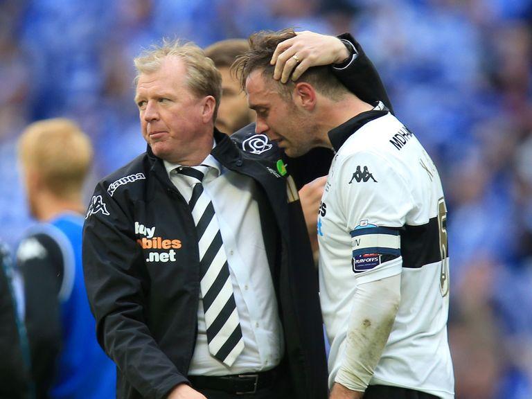 Derby boss Steve McClaren consoles skipper Richard Keogh