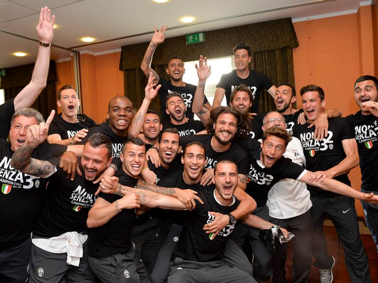 Juventus celebrate after their title win was confirmed