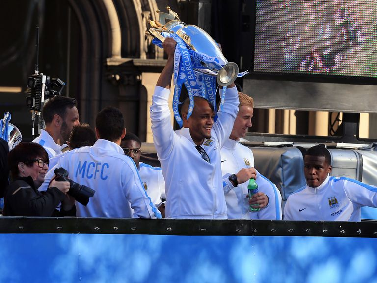 Vincent Kompaby celebrates with the Premier League trophy