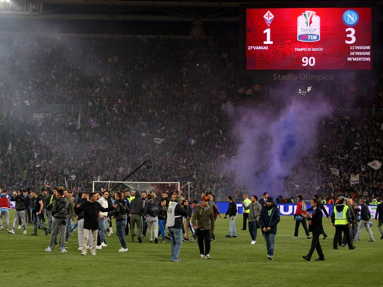 Napoli fans enter the field of play after the Coppa Italia final