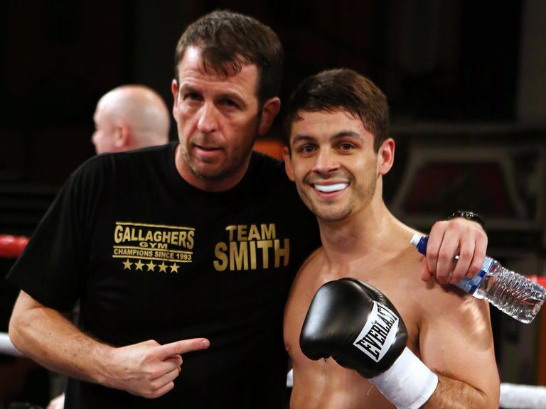 Smith celebrates with trainer Joe Gallagher