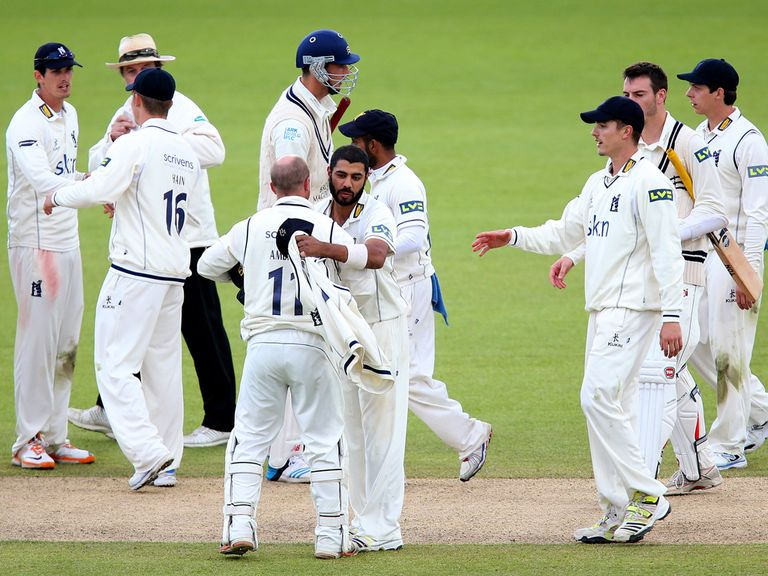 Warwickshire celebrate their three-day win at Edgbaston