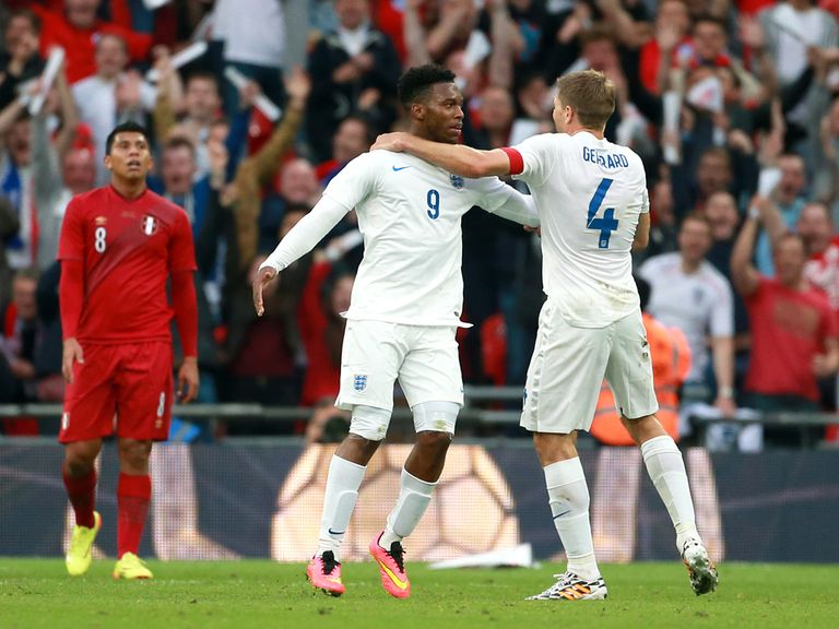 England's Daniel Sturridge celebrates scoring their first goal of the game with team-mate Steven Gerrard (right)