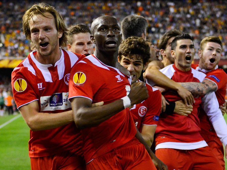 Sevilla players celebrate the dramatic ending to their semi-final with Valencia