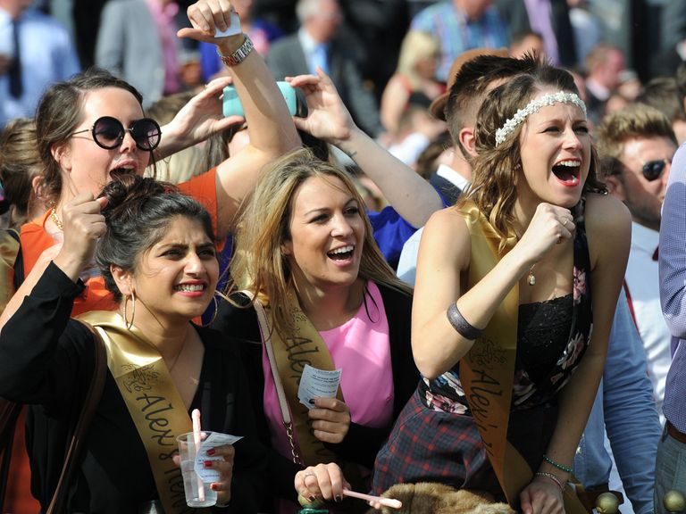 Racegoers cheer on the action at Haydock Park