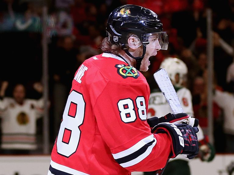 Patrick Kane celebrates the second of his third period goals