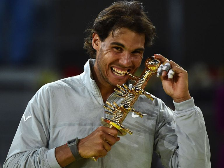 Spanish player Rafael Nadal poses with the trophy