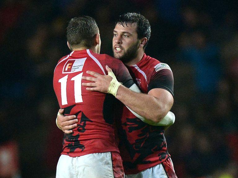 Nick Scott celebrates with team mate Nathan Vella