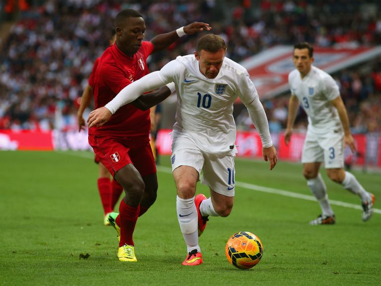 Wayne Rooney in action against Peru