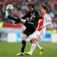 AMSTERDAM, NETHERLANDS - MAY 03:  Bojan Krkic of Ajax and Jeffrey Leiwakabessy of NEC battle for the ball during the Eredivisie match between Ajax Amsterda