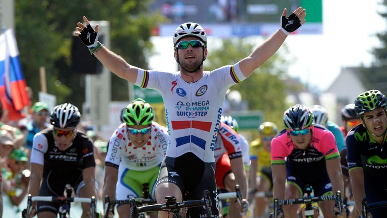 Mark Cavendish celebrates his victory in the British champion's jersey