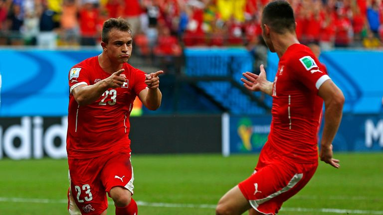 Xherdan Shaqiri: Celebrates with team-mate Josip Drmic