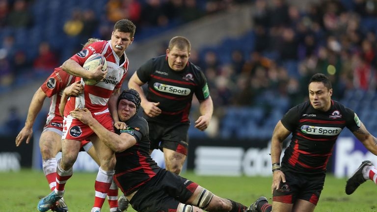 Grant Gilchrist tackles Freddie Burns of Gloucester during a the Heineken Cup match