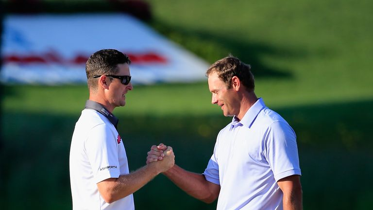 Justin Rose (left): Shakes hands with Shawn Stefani after their play-off ended at the first extra hole