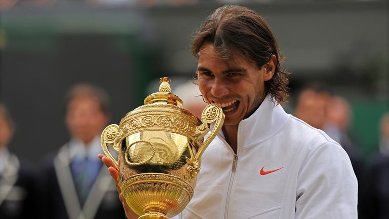 Rafael Nadal bites the Wimbledon trophy after winning the tournament in 2010