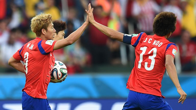Son Heung-Min (l): Celebrates with forward Koo Ja-Cheol after scoring his team's first goal