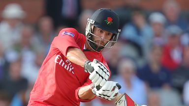 Tom Smith of Lancashire Lightning hits a six at Old Trafford