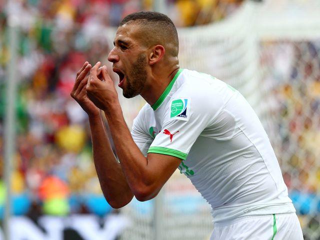 Algeria striker Islam Slimani celebrates