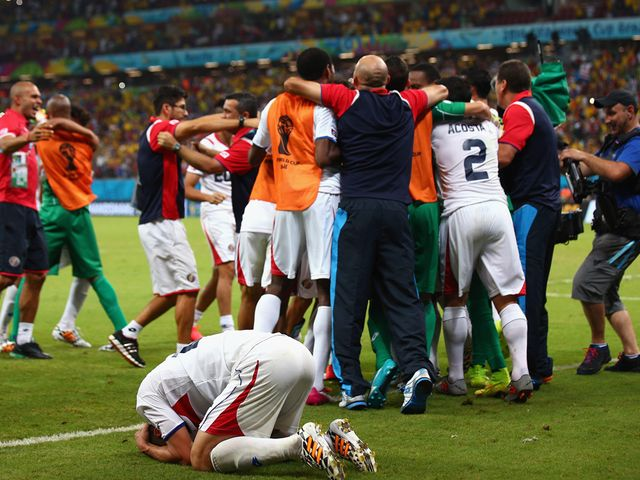 Costa Rica celebrate reaching the quarter-finals