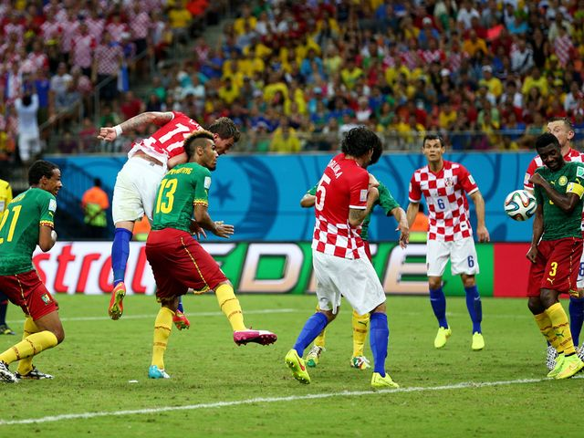 Mario Mandzukic heads home his first goal of the match