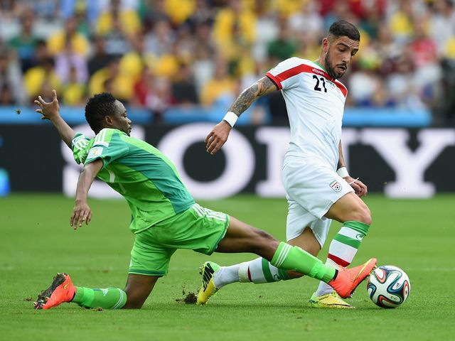 Ahmed Musa tackles Ashkan Dejagah