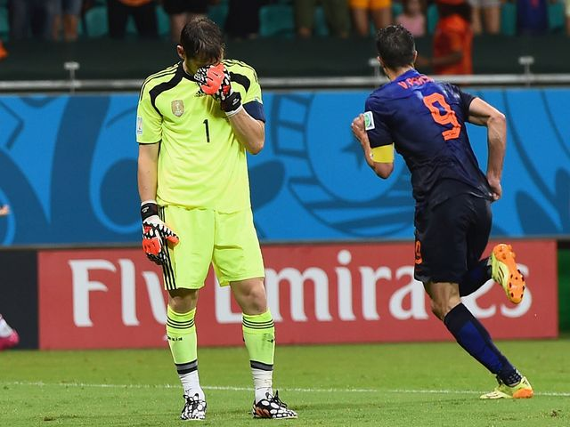 Iker Casillas can't look as Robin van Persie celebrates