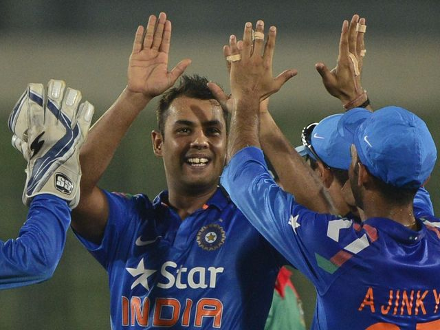 Stuart Binny celebrates one of his six wickets