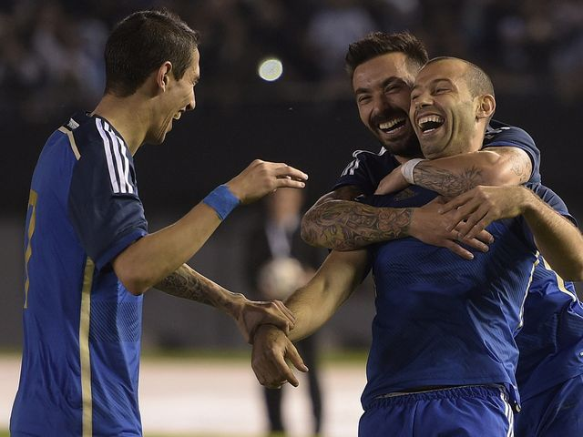 Javier Mascherano celebrates with Ezequiel Lavezzi and Angel Di Maria