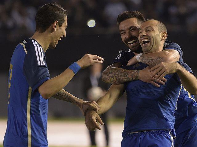 Javier Mascherano celebrates with Ezequiel Lavezzi and Angel Di Maria
