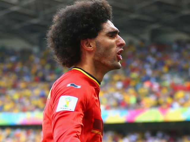 Marouane Fellaini of Belgium celebrates after scoring his side's equaliser
