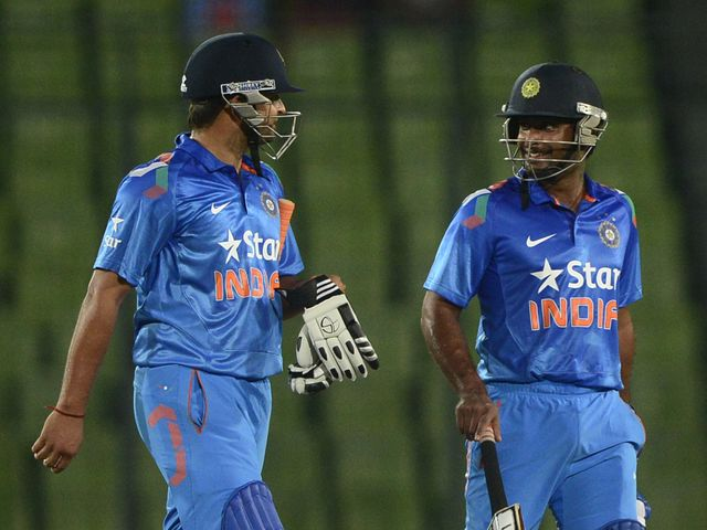 Suresh Raina and Ambati Rayudu walk off the field after victory