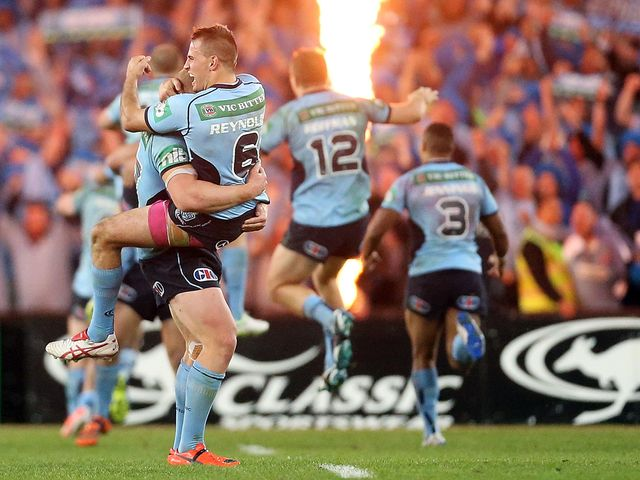 The Blues celebrate after Trent Hodkinson scored the only try of the match in Sydney