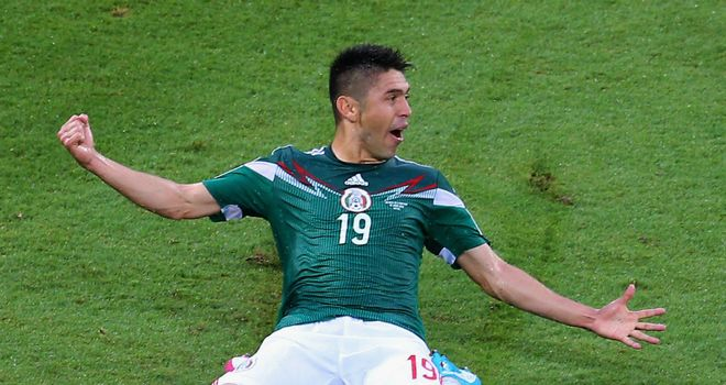 Oribe Peralta: Celebrates his goal for Mexico