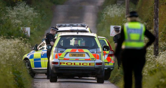 Police investigate the scene at Coldstream where two people after thought to have died