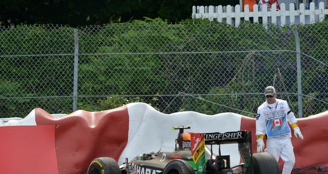 The crashed car of Sergio Perez