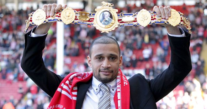 Curtis Woodhouse: Holds aloft his British light-welterweight belt before a game at Sheffield United's Bramall Lane