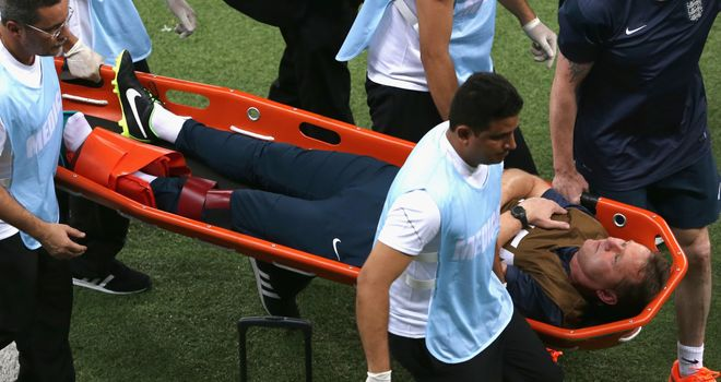 England trainer Gary Lewin is stretchered off the field after dislocating his ankle