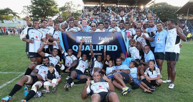 The Fiji team celebrate after qualifying for the 2015 Rugby Union World Cup