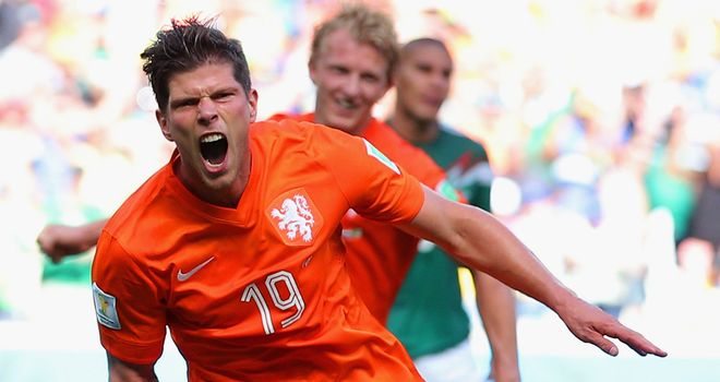 Klaas-Jan Huntelaar wheels away to celebrate after his last-gasp winner