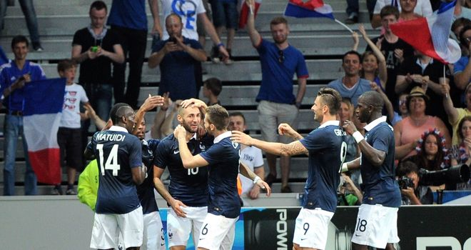 Karim Benzema (centre): Congratulated after scoring in 8-0 win over Jamaica