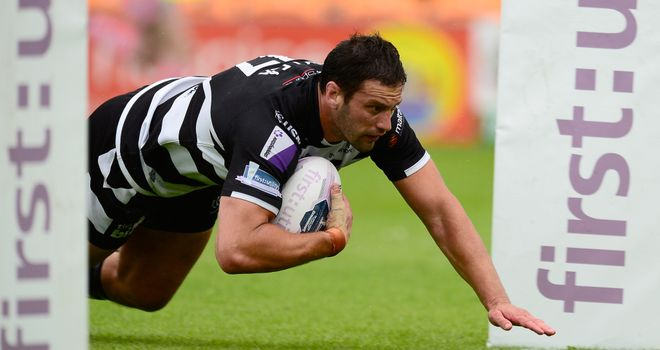Danny Galea dives over for a Widnes try