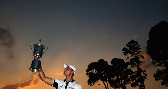 Martin Kaymer celebrates with the trophy after his eight-stroke victory at the 114th US Open