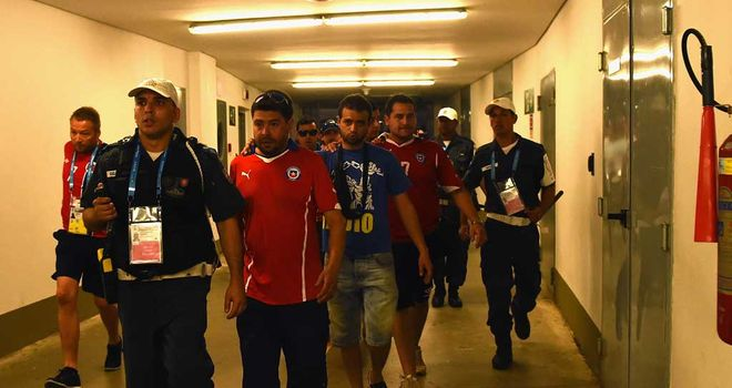 Chile fans: Were lead out of the ground by security and police