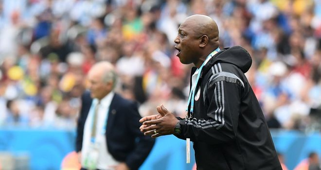 Nigeria's coach Stephen Keshi gestures as Argentina's coach Alejandro Sabella looks on during the Group F football match between Nigeria and Argentina