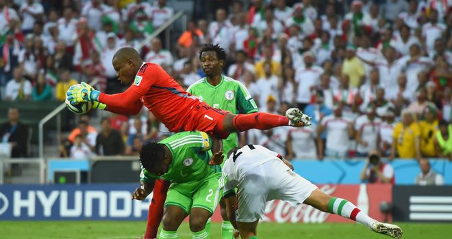 Vincent Enyeama of Nigeria makes a save over Joseph Yobo and Ashkan Dejagah of Iran