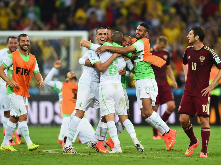 Algeria celebrate reaching the World Cup knockout stages