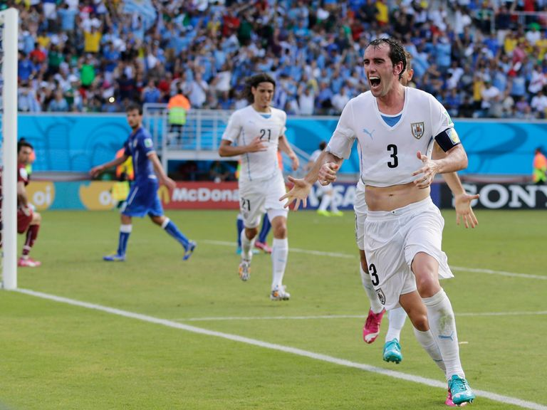Diego Godin celebrates his winner for Uruguay