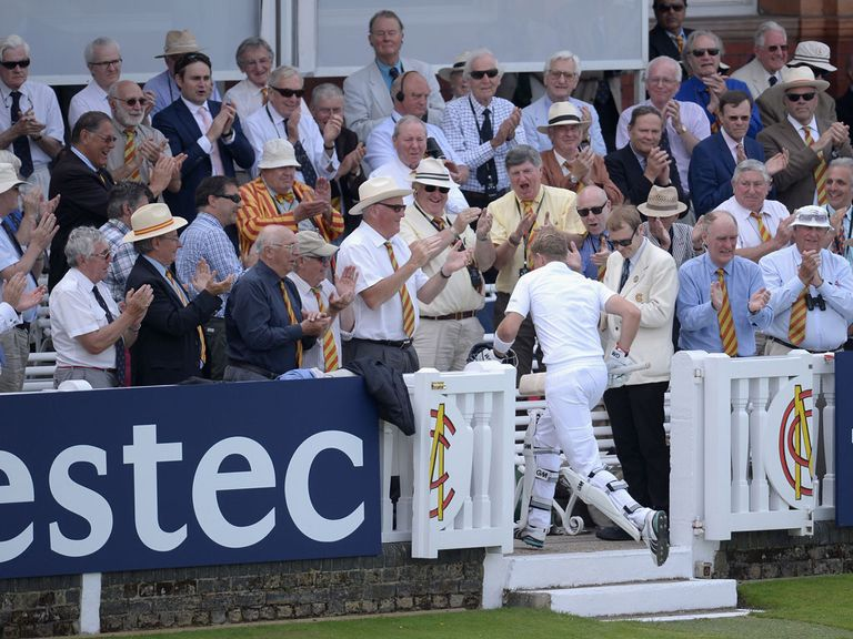 Joe Root returns to the pavilion after his unbeaten 200