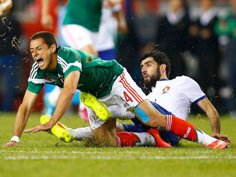 Mexico striker Javier Hernandez takes a tumble